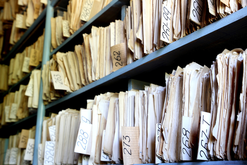 shelves full of files in an old archive