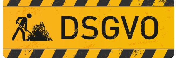 gelbes Schild Baustelle DSGVO mit Bauarbeiter-Icon